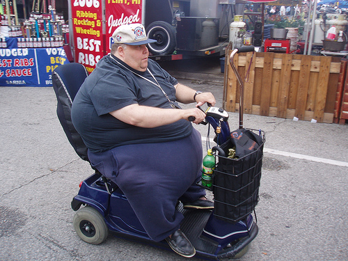 Decline, decay, denial, delusion and despair fat guy on scooter